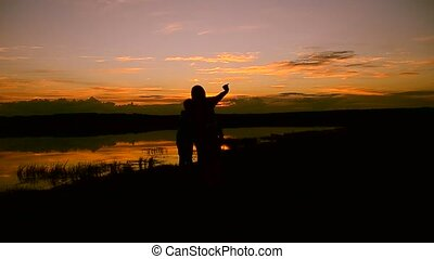 Children with mother make selfie phone at sunset