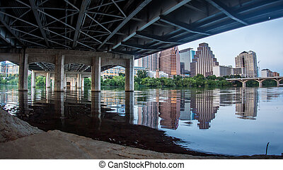 City Skyline from under the bridge, reflected on lake