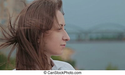 Close up of young woman in embankment