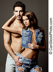 jeans passion - Beautiful sexual couple topless playing in...