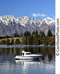 Queenstown, New Zealand - Aug 27, 2016. Small yacht on the...