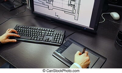 Close up of the hand of a engineer editing scheme in CAD...