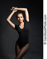 Young, beautiful model posing in a studio - Young, beautiful...
