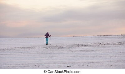 Cross-country skiing on field. - Young girl on cross-country...