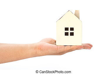hand holding a house model on a white background