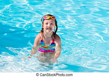 Child learning to swim in pool - Happy little girl learning...