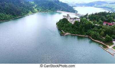 aerial view of castle on lake bank
