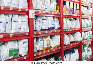 Pet Food Packets At Store - Pet food packets arranged on...