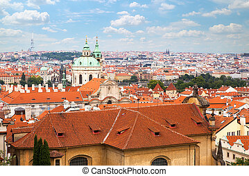 Aerial view over Old Town in Prague with domes of churches,...