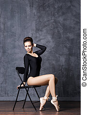 Young and beautiful ballerina with a perfect body - Young...