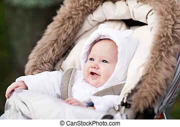 Little baby in stroller - Happy laughing baby enjoying a...