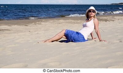 young woman relaxing on the beach - young woman relaxing on...