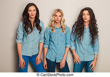 three fashion casual women posing in studio