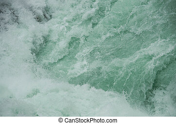 Strong rushing streams of water close-up background