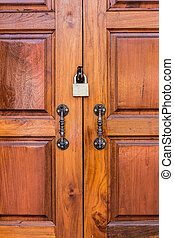 Wooden doors with padlock