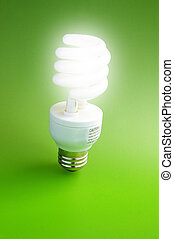 Fluorescent light bulb standing on green background (green...