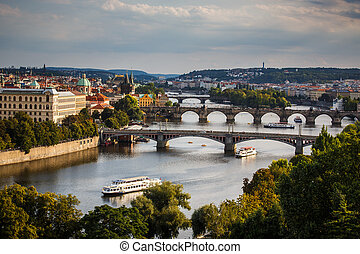 Prague with its splendid bridges over the Vltava river, city sunset panorama, Czech Republic