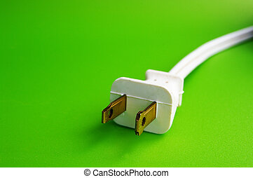 Power plug on green background green power
