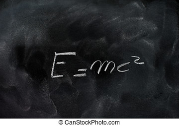 Einstein relativity formula e=mc2 on black chalk board -...