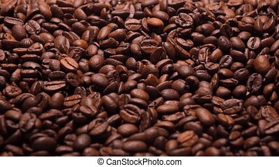 Roasted coffee beans zoom in, 4K shot - Roasted coffee beans...
