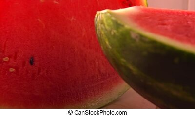 Cut watermelon closeup 4K pan shot - Cut water melon closeup...