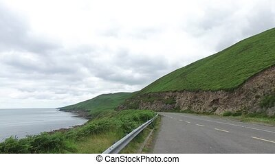 asphalt road at wild atlantic way in ireland - travel and...