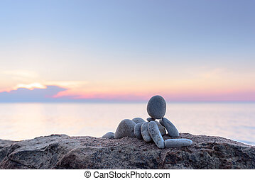 Statuette on morning beach - Figurine of woman of the stones...