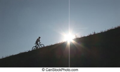 mountainbiking up hill wide