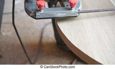 Carpenter is making furniture