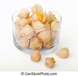 Physalis in a glass bowl on white background Edible ripe...