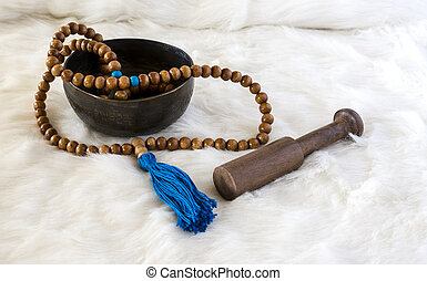 Wooden beads with blue tassel on white fur - Still life of...