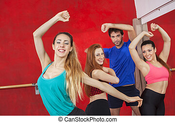 Portrait Of Woman Practicing Zumba With Friends