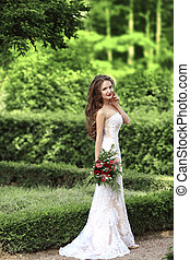 Wedding Portrait Of Beautiful Bride with long wavy hair...