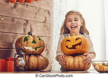girl with carving pumpkin - Happy halloween! Cute little...