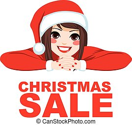 Christmas Sale Woman - Woman wearing Santa hat smiling with...