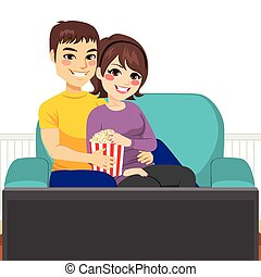 Couple Movie Couch - Cute young couple watching movie...