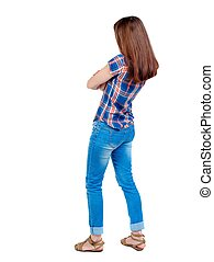 back view of standing young beautiful woman - back view of...
