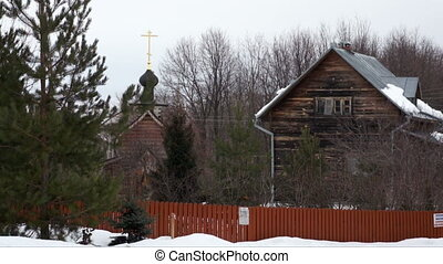 Monastery in winter. - Wooden monastery buildings with bells...
