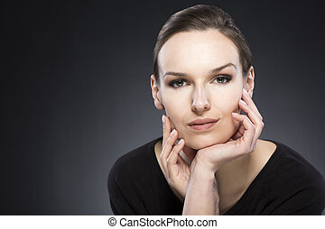 Make-up for every day - Portrait of a young woman in black...
