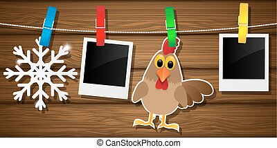 Blank photo frames, rooster and snowflake on a clothesline. Vector illustration.