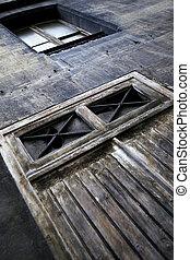 Facade of a slum - Door closed on the facade of an old...