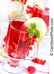 Refreshing summer ice tea or lemonade with fresh fruits