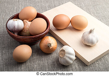 Ingredients for cooking in retro style - raw eggs, onions...