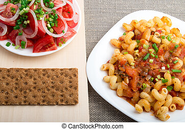 Top view on Cavatappi Pasta on textile background - Top view...