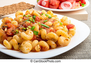 Cooked pasta cavatappi with vegetables sauce closeup -...