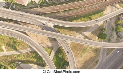 Aerial footage of highway and overpass with cars and trucks....