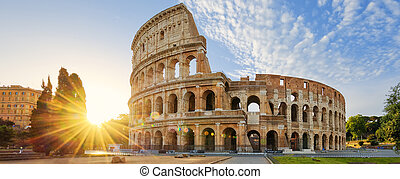 Colosseum in Rome and morning sun, Italy - Panoramic view of...