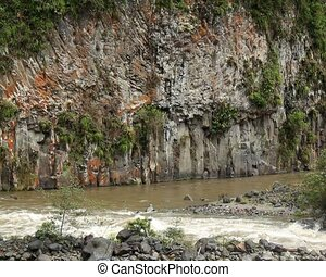 Basalt columns beside the rio Quijo - In the foothills of...