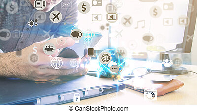 Businessman using mobile smart phone.hand touching screen social icons.