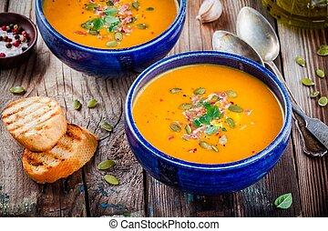 homemade autumn butternut squash soup with pumpkin seeds,...